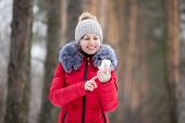 Happy Smiling Female In Red Winter Jacket With Mobile Phone, Outdoors