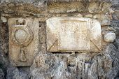 picture of legion  - Simbol of roman legion on the wall of aqueduct near Caesarea in Israel - JPG
