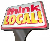 Think Local words on a sign advertising community stores or business for buying from neighborhood merchants or sellers and supporting your nearby companies