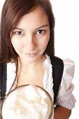 Closeup of a Beautiful woman holding Oktoberfest beer stein.