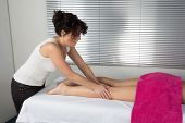 Side View Of A Woman Legs Receiving A Massage Therapy