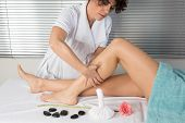 pic of calves  - physiotherapist massaging the calves of a woman - JPG