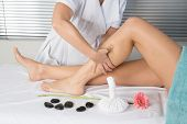 foto of calves  - physiotherapist massaging the calves of a woman - JPG