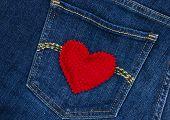 Red heart on blue denim jean pocket