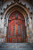 stock photo of gothic  - Large cathedral gothic door with gothic arcades