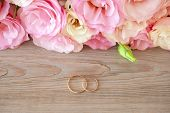 Gentle Vintage Wedding  Background with gold Rings and beautiful flowers