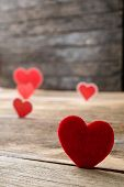 Red Valentine Hearts On Old Rustic Wooden Background