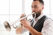 stock photo of trumpets  - Improvising with his trumpet - JPG