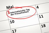 An image of a calendar detail shows may the 3rd World Press Freedom Day in german language