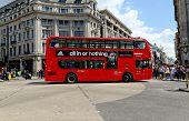 A London red bus bearing Adidas advertisement
