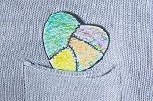 painted heart paper in a pocket