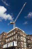 Building Rennovating with crane and scaffolding