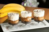 picture of whipping  - Banana caramel parfait desserts with fresh whipped cream and chocolate cookie crumbles - JPG