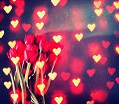 tulips on a wooden board. good for mother's day, easter, valentine's day or other holidays symbolizing love toned with a retro vintage instagram filter effect