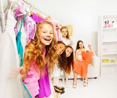 Happy cute girls in the shop choosing clothes