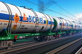 image of railroad car  - Fast train with tankcars with biofuel with motion blur effect - JPG