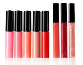 Beautiful lip glosses, isolated on white