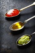 Tomato sauce, olive oil and pesto - Traditional Italian cooking