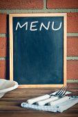 the menu blackboard before brick wall
