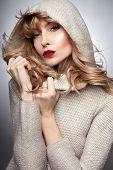 Beauty Portrait Of Blonde Woman In Hood.
