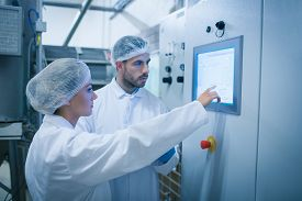picture of food plant  - Food technicians working together in a food processing plant - JPG