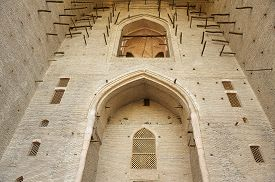 foto of sufi  - Unfinished exterior of the beautiful medieval mausoleum of the famous 12th century poet and sufi Khoja Ahmed Yasavi in Turkistan - JPG