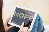 stock photo of aspergers  - Teen using a tablet pc sitting on the floor against autism message of hope - JPG