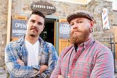 image of facial piercings  - Portrait Of Two Hipster Barbers Standing Outside Shop - JPG
