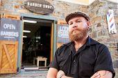 image of facial piercings  - Portrait Of Hipster Barber Standing Outside Shop - JPG