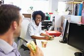 stock photo of lunch  - Two colleagues having a lunch break at work - JPG