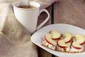 pic of crisps  - Crisp bread with cream cheese and apples and cup of tea horizontal selective focus - JPG