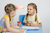 stock photo of 6 year old  - Two girls of four and six years of sitting at the table and draws and paints and pencils - JPG