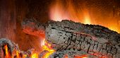 picture of ember  - Burning embers of wood logs in a fireplace - JPG