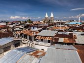 stock photo of angle  - Wide angle view of the architecture and typical roofs in Stone Town - JPG
