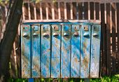 stock photo of mailbox  - Old blue mailboxes with rust in the sun - JPG