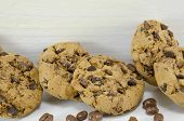 foto of chocolate-chip  - Chocolate chip cookies and chocolate grains on white - JPG