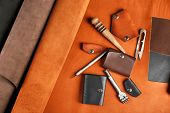 stock photo of leather tool  - Hand made leather man accessories and tools - JPG