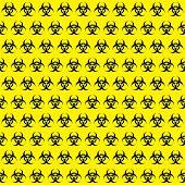 picture of hazard  - Bio hazard sign pattern on yellow background - JPG