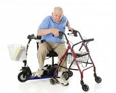 stock photo of crippled  - A senior man transferring from his electric scooter to his wheeling walker - JPG