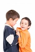 stock photo of bullying  - Bigger boy bullying a smaller one isolated in white - JPG