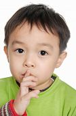 stock photo of silence  - A little boy keeping silence by covering his mouth by hands - JPG