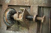 stock photo of ferrous metal  - Old rusty metal roller with rack texture or background - JPG