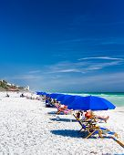 picture of emerald  - Tourists enjoying the white sands and green ocean water of Florida