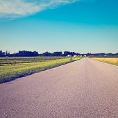 foto of bavaria  - Asphalt Road Between Wheat Fields in Bavaria Retro Effect - JPG