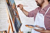 picture of finger-painting  - Young artist painting with oilpaints on canvas - JPG