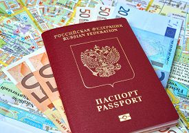 stock photo of passport cover  - Russian passport and Euro banknotes on the map background, the concept of tourism
