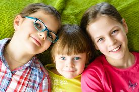picture of three sisters  - Happy children having fun together - JPG