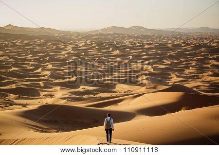 Man lost in desert dunes