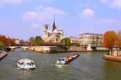 Passenger cruise at Cathedral Notre Dame river Seine Paris France
