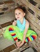 Preschool Girl With Tutu And Candy Sucker